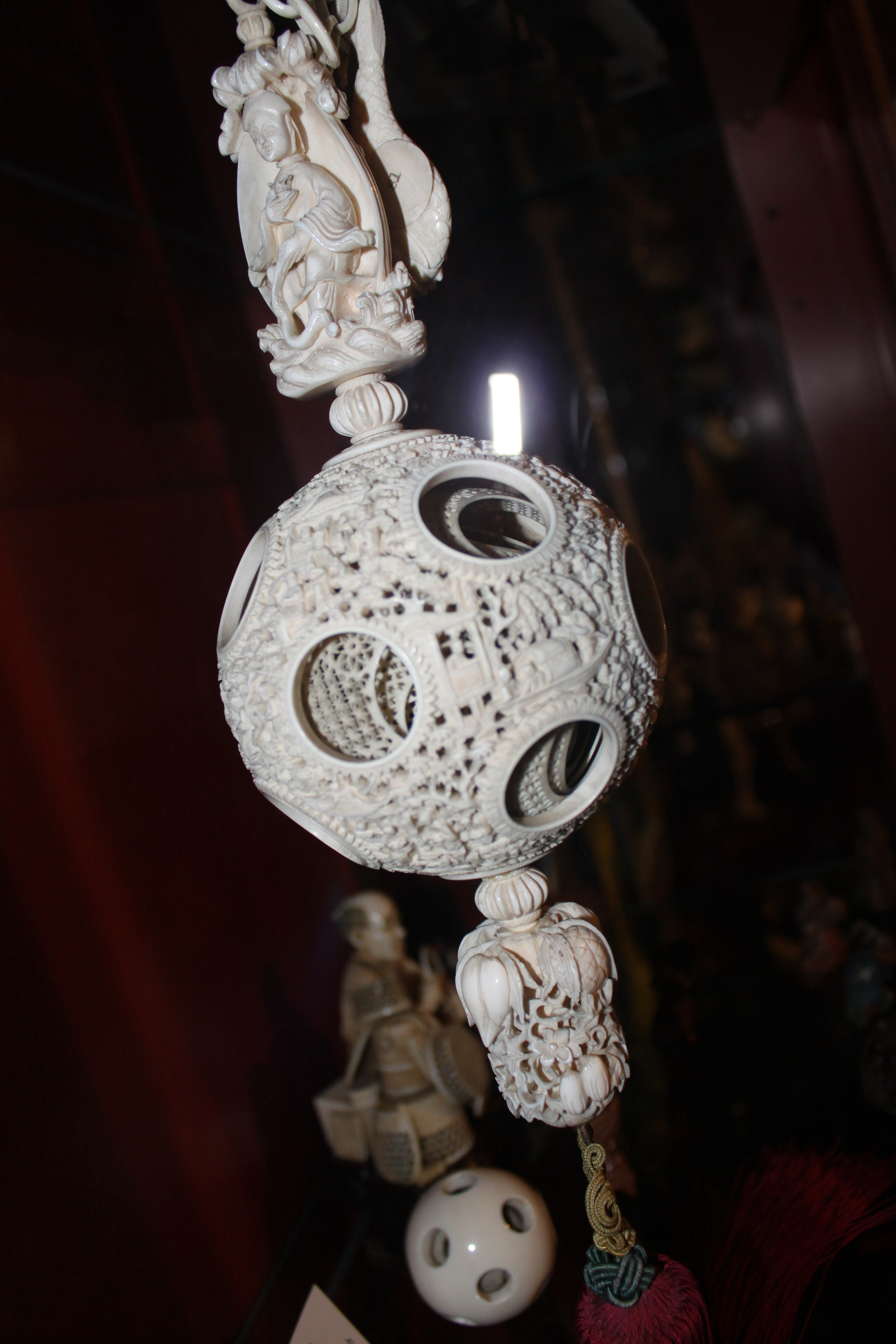 An intricately carved set of sixteen, lace-like balls, were carved in place, one within the other from a single piece of ivory. The set was likely used as part of a Hindu religious ceremony. Each of the sixteen balls fully rotates within its larger counterpart and is said to have required three generations in India to complete.