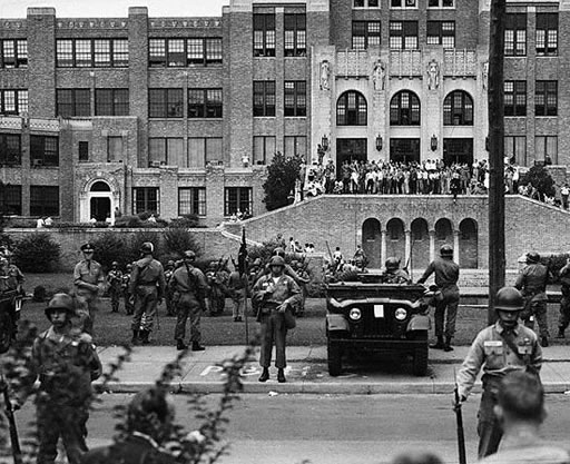 Soldiers stand guard to enforce the law at Little Rock High School, September 26, 1957