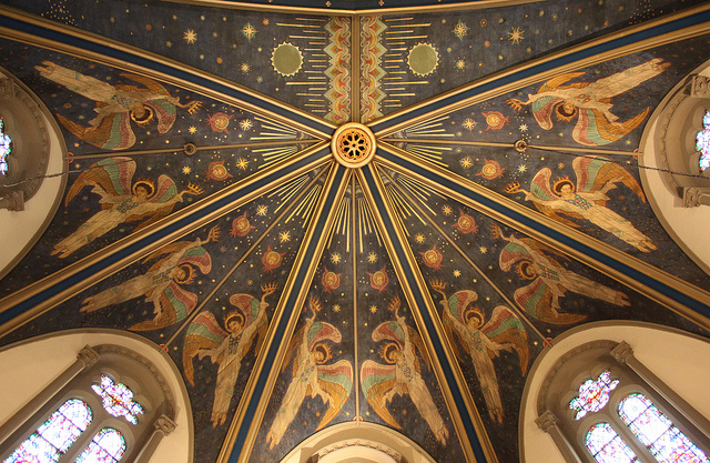 "Guy Leber's ""The Angels of Glory"" is painted on the apse ceiling."