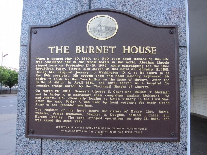 The marker is located on the corner of the building on Vine Street.