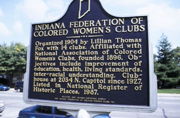 The historical marker next to the building