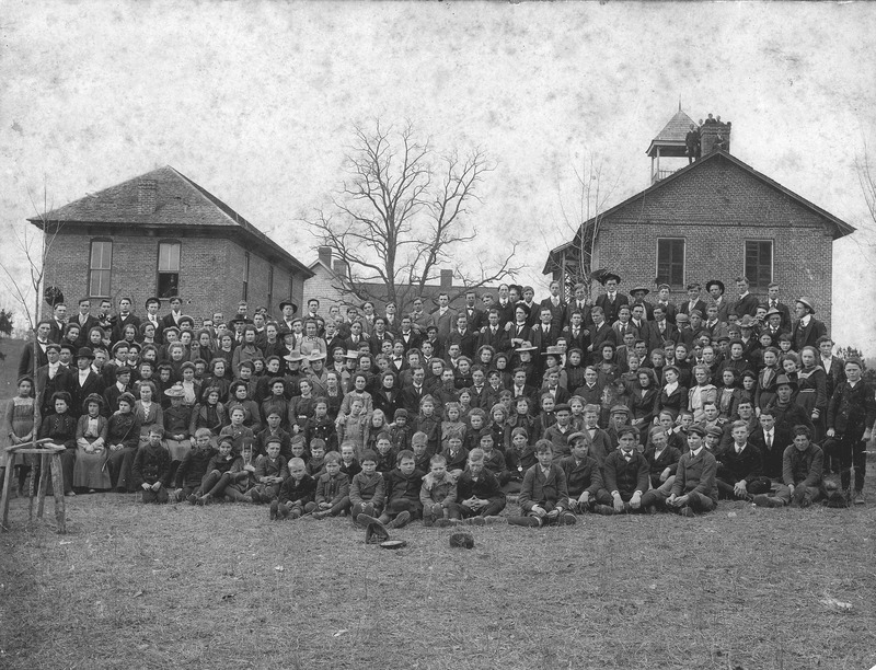 The students and faculty of Mars Hill College assembled on the upper quad in 1902. Founders Hall can be seen in the back left of this photo.