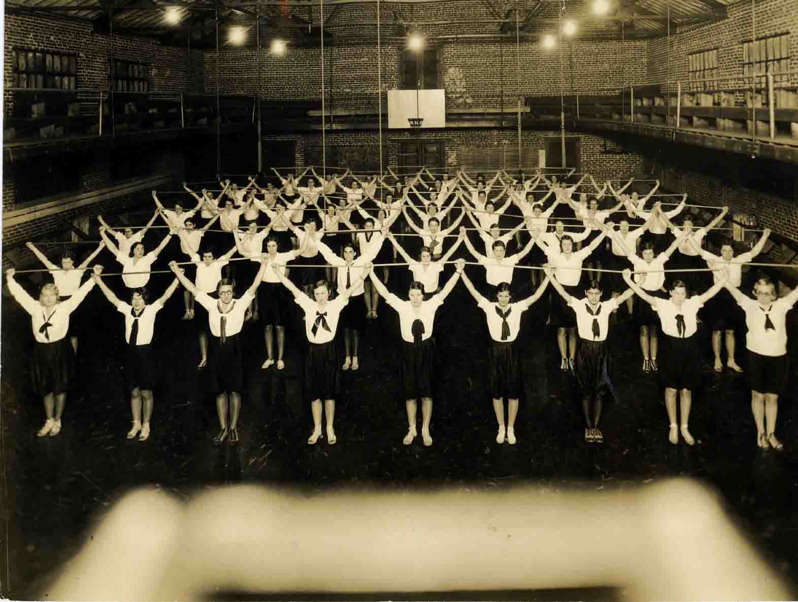 Female students exercising in McConnell Gym, 1924