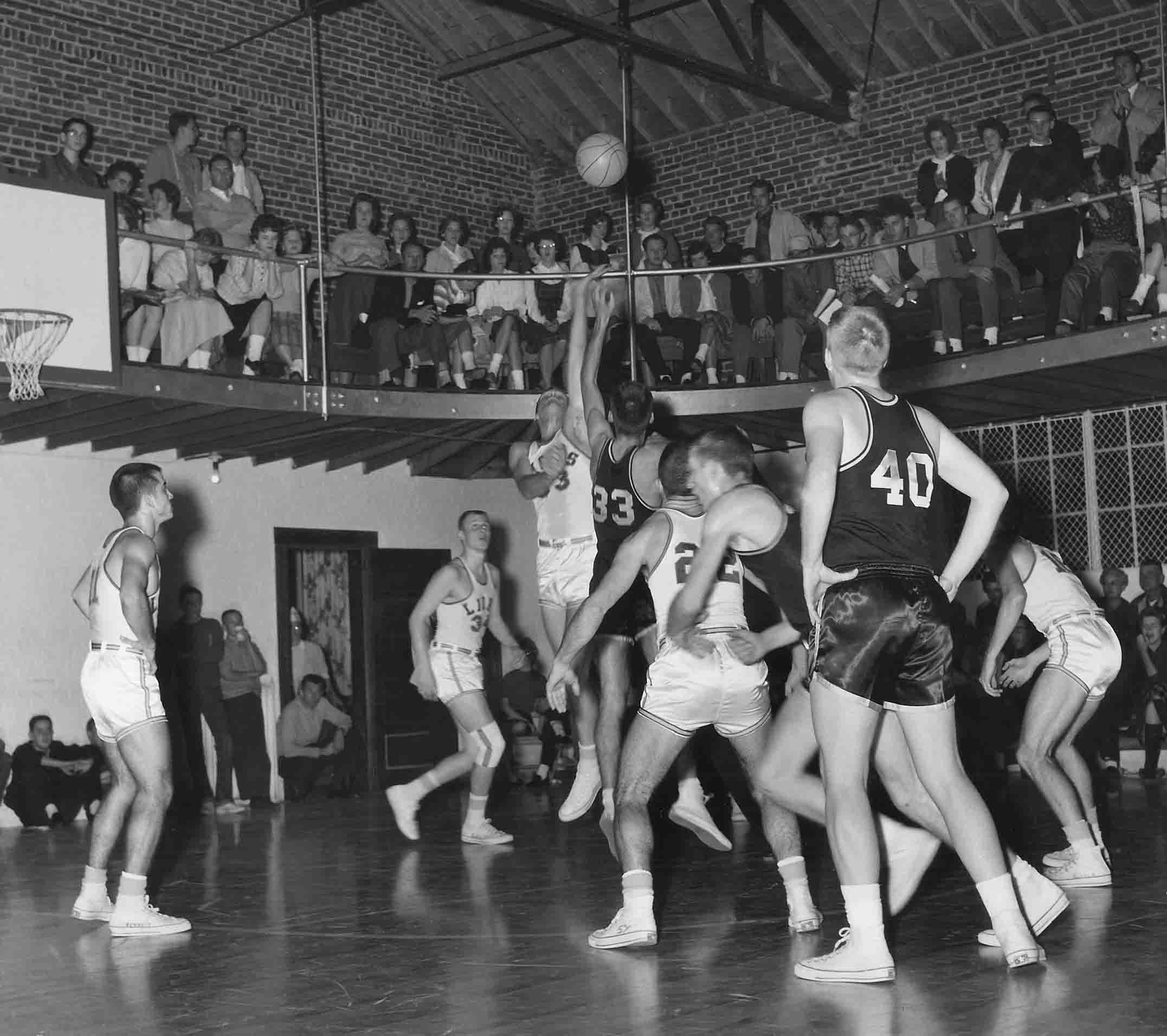 Men's basketball game taking place in McConnell Gymnasium