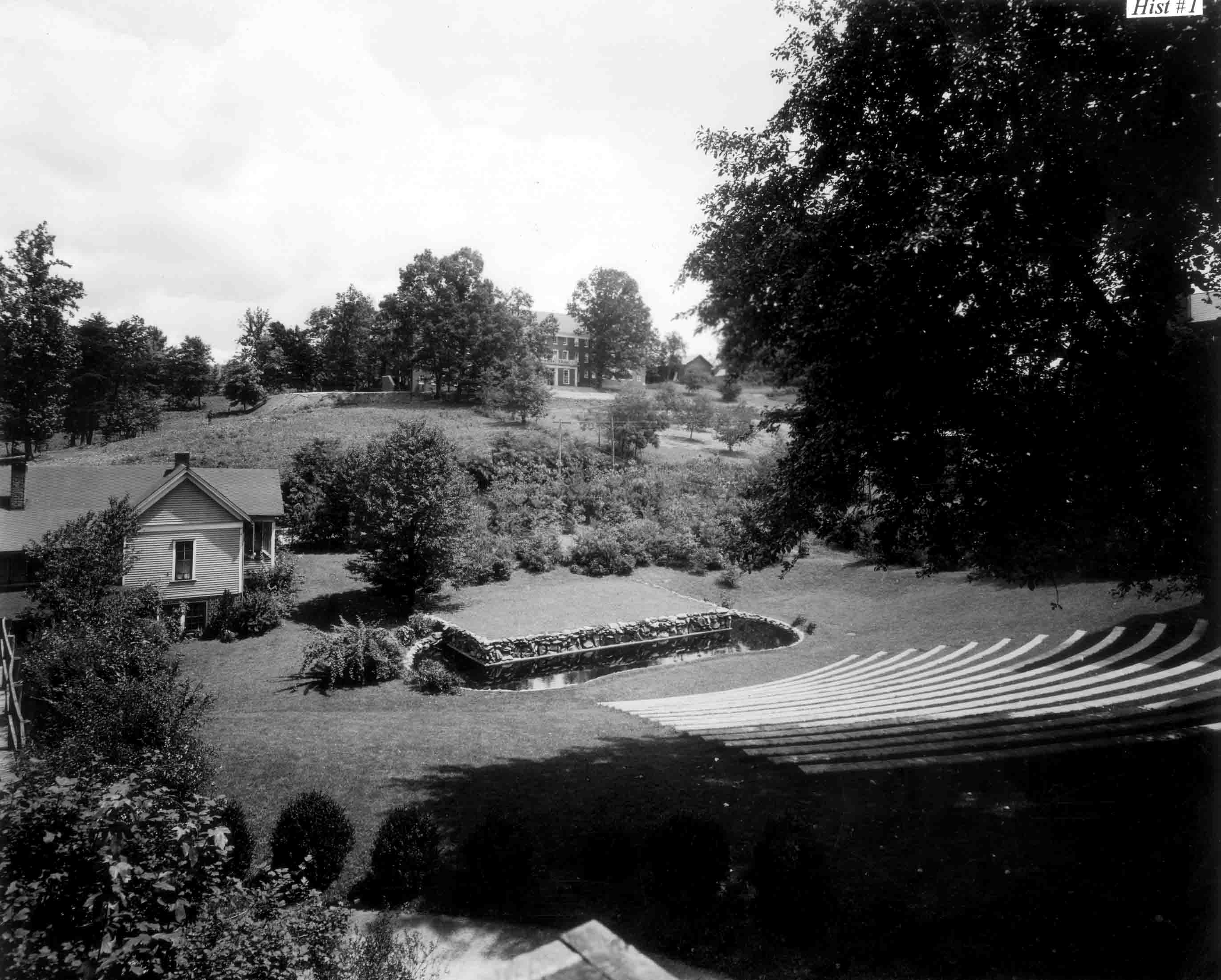 Amphitheater and Wood Cottage. The wood cottage is no longer standing on campus.