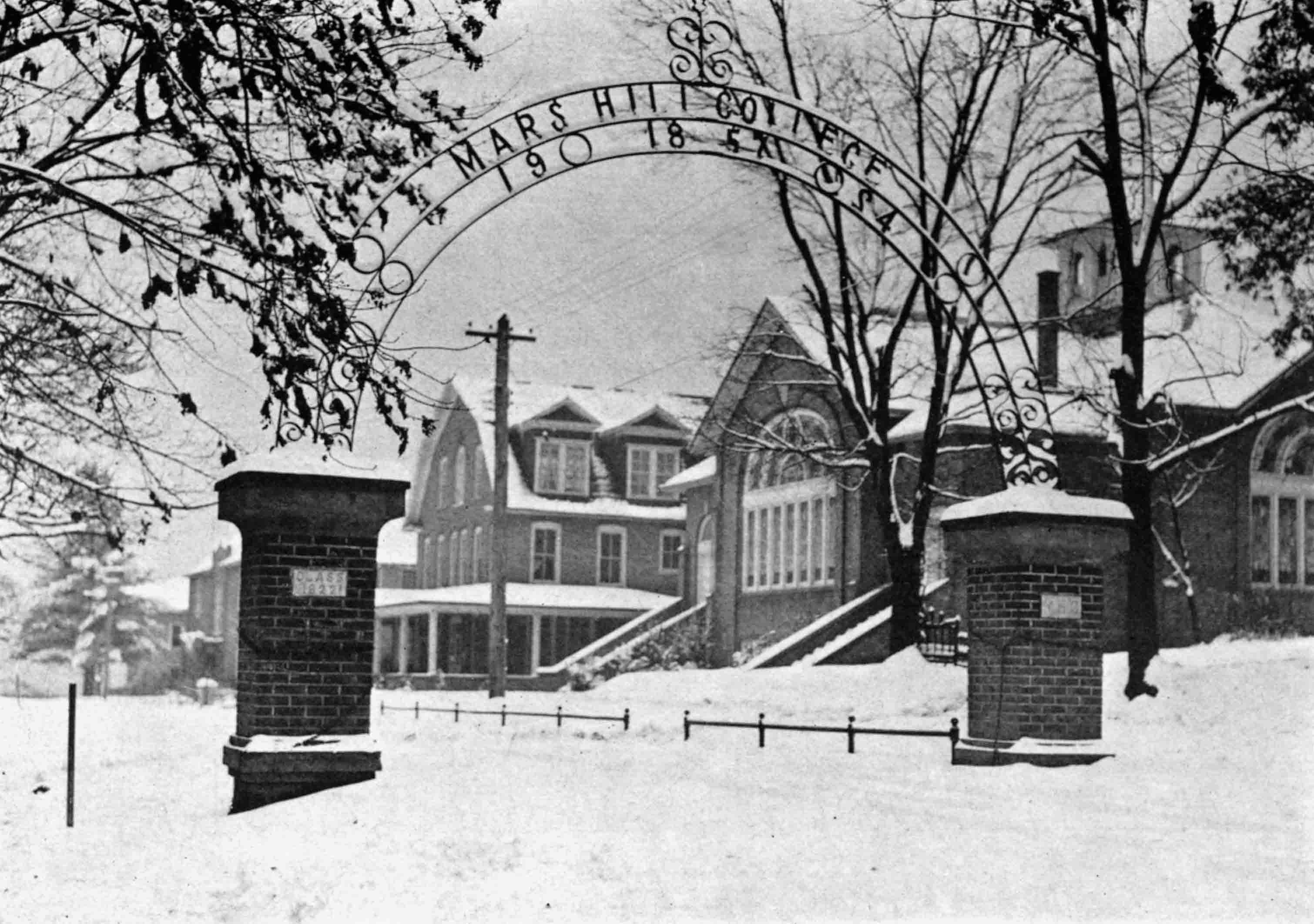 View of College Street from the Old East Gate, 1930. Spilman Hall can be seen next to Owen Theatre