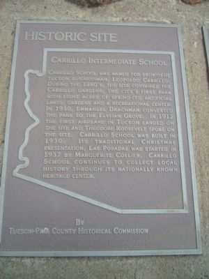 This historical marker is located on stone monument in front of the entrance.