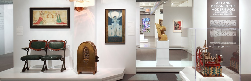 A view through several galleries shows paintings and sculptures.