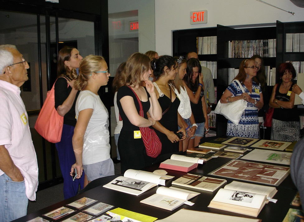 """Patrons view part of the Wolfsonian's rare books collection that were part of its """"Women in Motion"""" exhibition."""