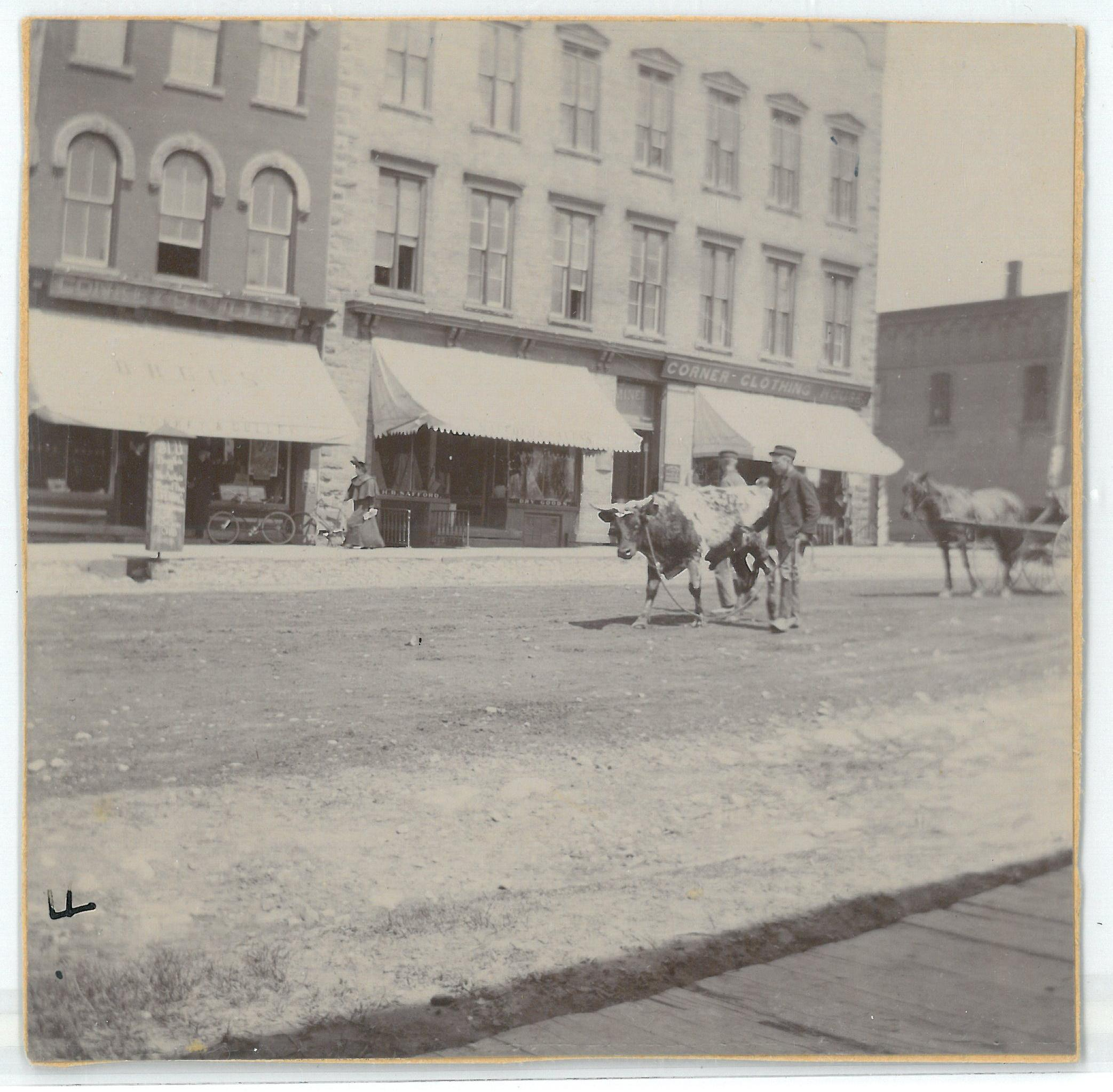 Photo of the Miner Block from the opposite side of the street. Courtesy of the St. Lawrence County Historical Association,