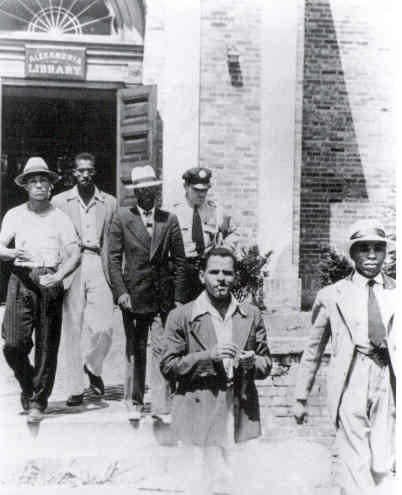 Police arrest Tucker and the four other men after they refused to leave the white-only library.