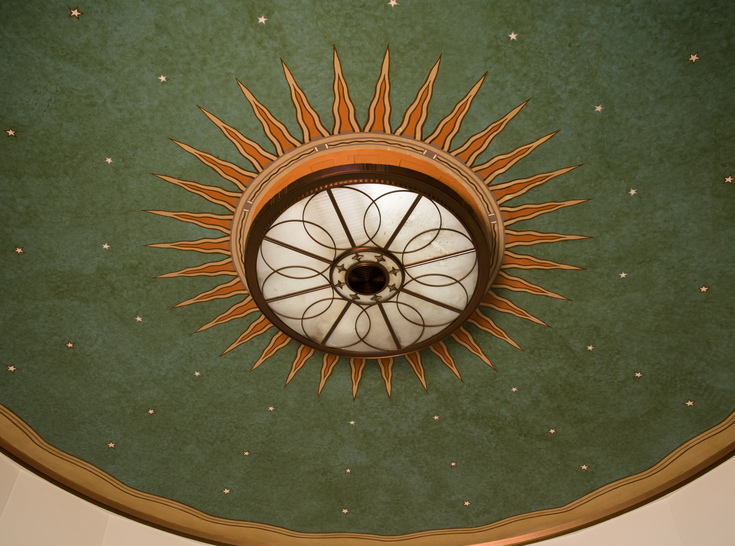 A close up of the interesting light fixture within the lobby.