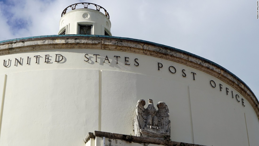 The exterior of the post office features a stone eagle and decorative cupola atop its roof.