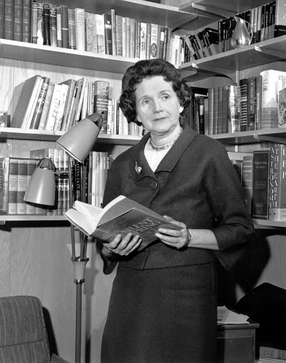 Rachel Carson reading another book about nautre, and how to preserve it.