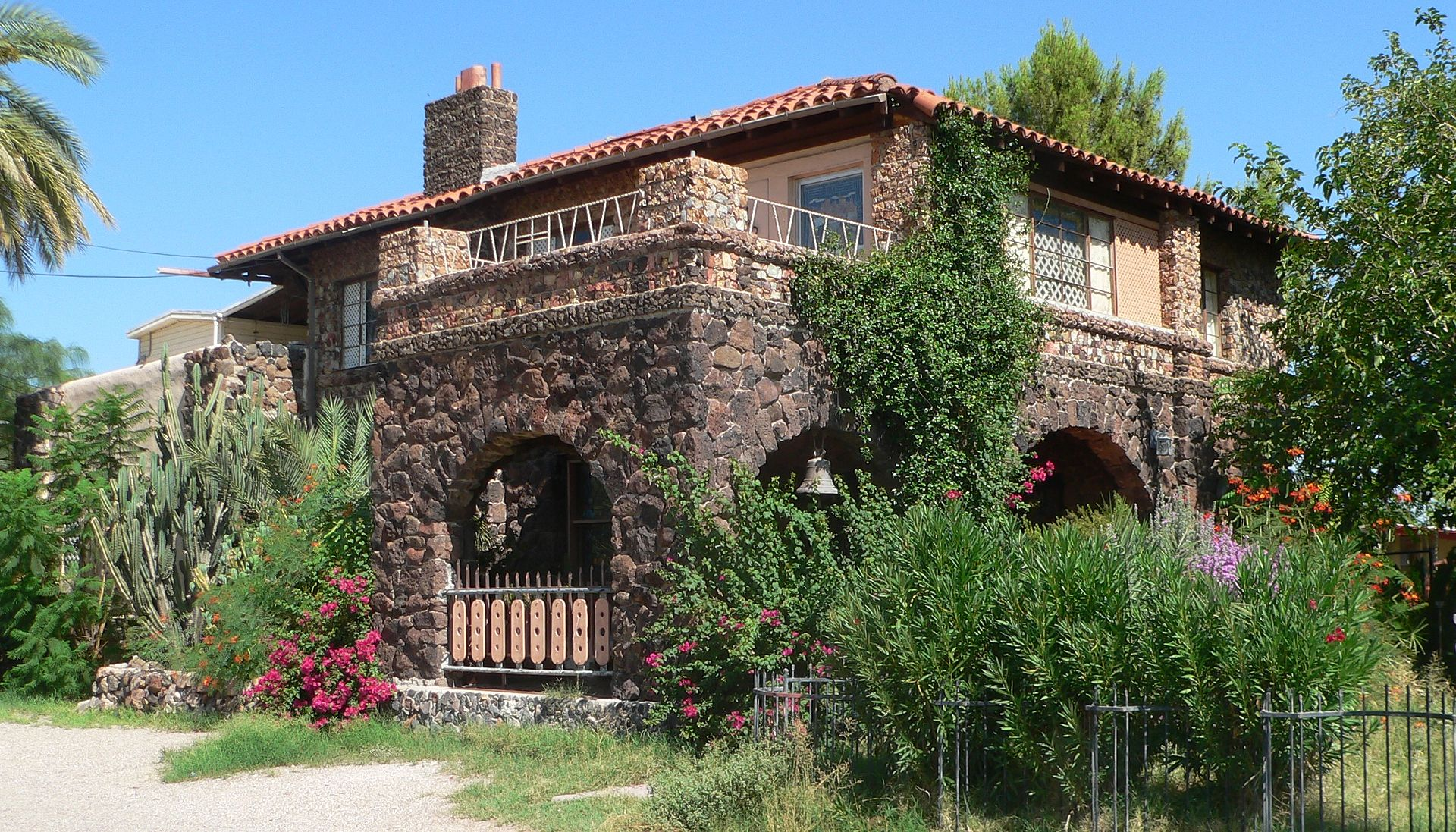 The Copper Bell Bed and Breakfast building was constructed around 1910 and is one of the few examples of volcanic stone construction in Tucson.
