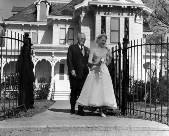 The President escorting his daughter from their house to her wedding in 1956, three years removed from his presidency.