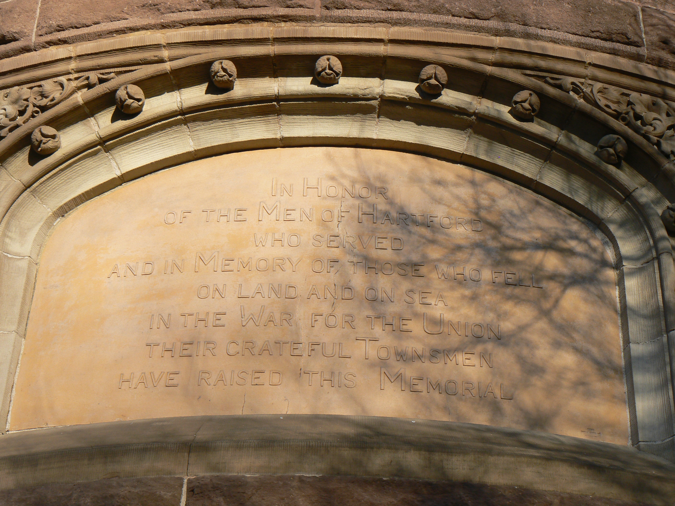 Inscription on the Southeast side of the East tower.