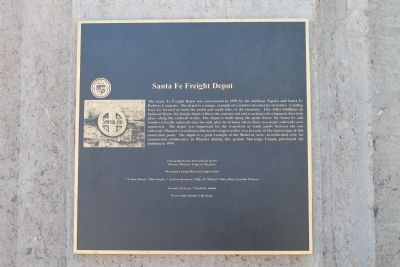 The historical marker attached to the exterior wall.