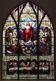 Stained glass window inside church.