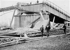 The bridge after it collapsed, as seen from the Ohio side of the river.