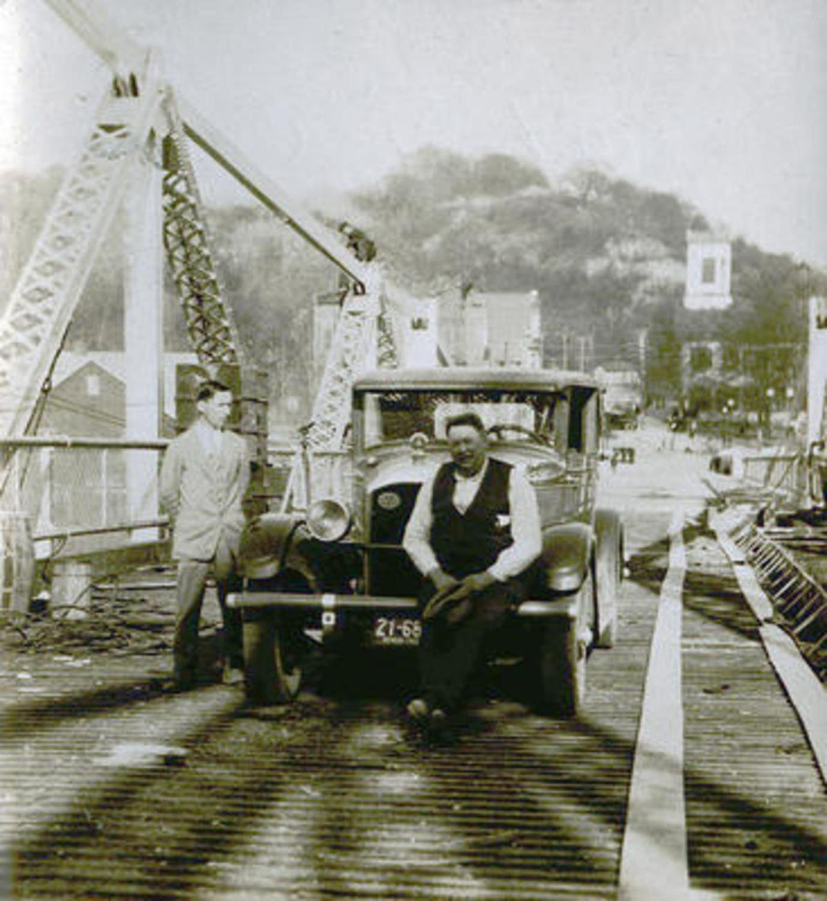 In 1928 Engineer Charles Vogel (Left) and George Cumpston (Center) were the first two people to cross the Silver Bridge in a vehicle after its construction.
