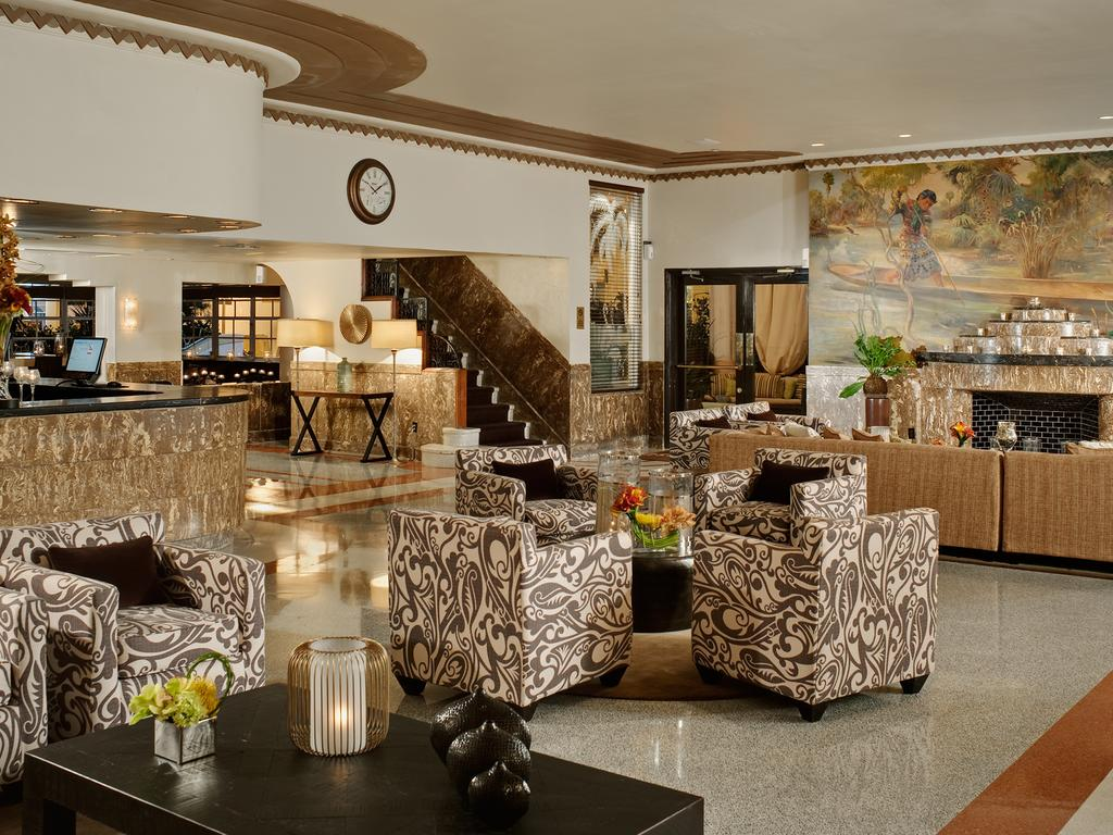 Earl Lapan's Everglades mural can be seen over the lobby's faux-marble fireplace.