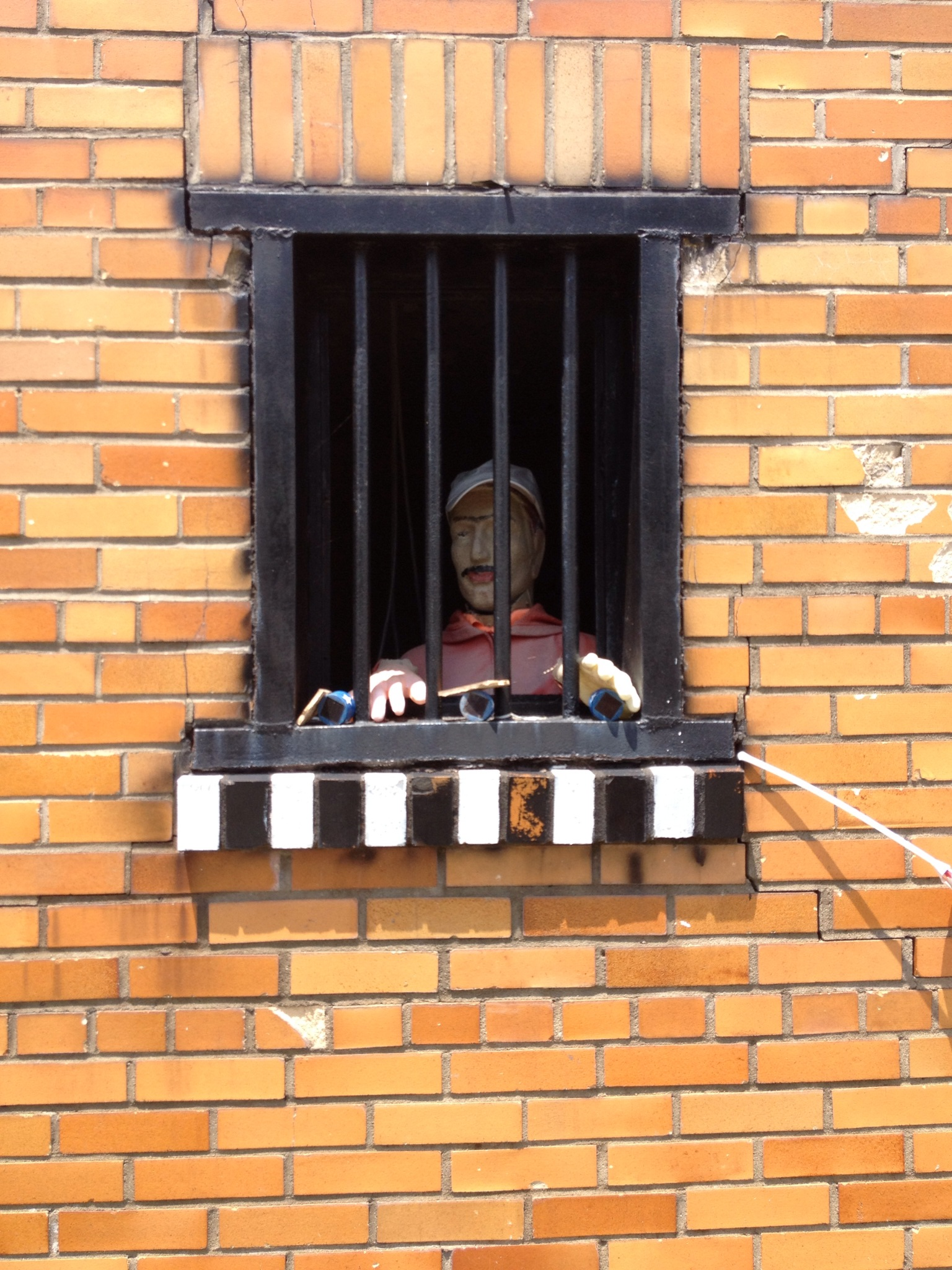 The jail features a mannequin in each of the windows