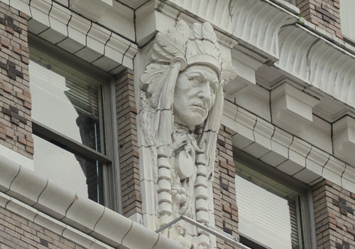 The building features Terra Cotta and ornate carvings such as this caricature of a Native American leader.