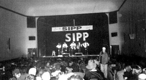 Historical picture of a concert going on in the theatre