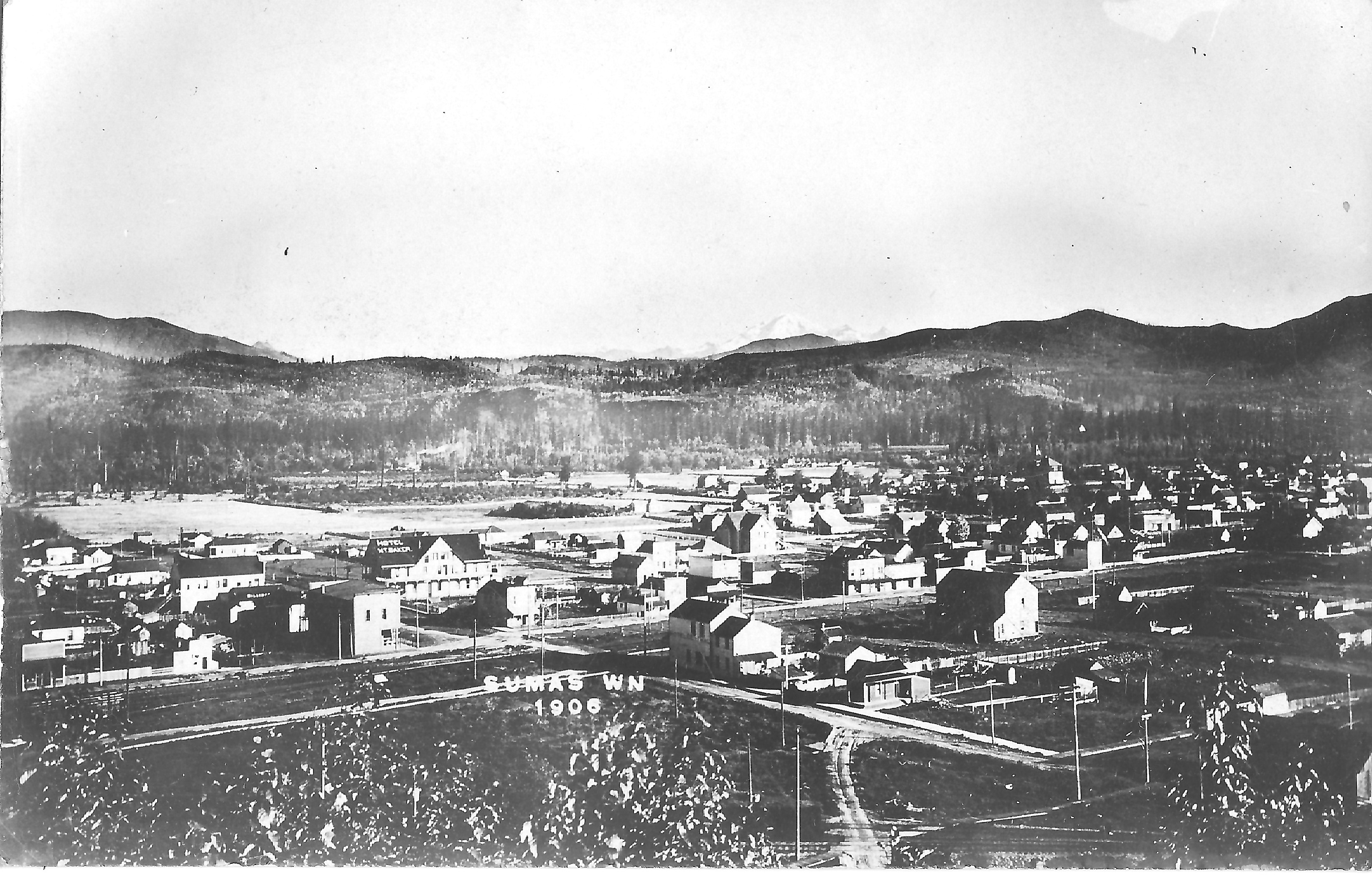 A view of Sumas in 1906 looking eastt towards Mt. Baker.  The photograph was taken from a viewpoint on Barker's Hill which has since been renamed Moe's Hill.