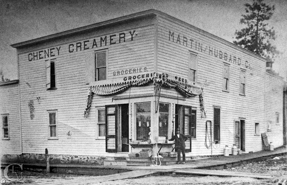 Frank Martin stands outside the creamery that he and Willis P. Hubbard established in 1890.