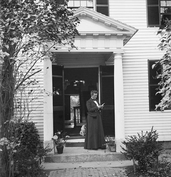 Sarah Orne Jewett standing in the doorway of the house in which she was born in 1849.