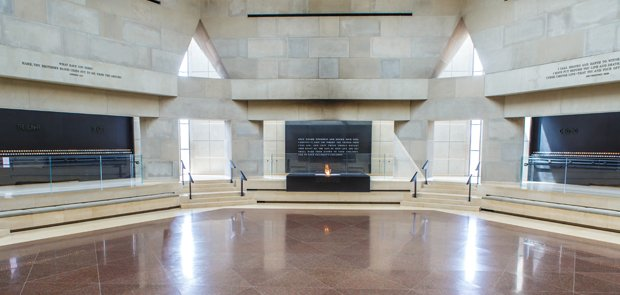 Hall of remembrance at the USHMM. Here, visitors are able to light memorial candles to remember the lost lives. The eternal flame is also shown here in the center of the room surrounding the names of concentration and death camps.
