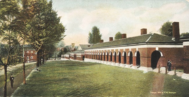 "Postcard of West Range near the middle the pediment of ""Hotel C"". To its left is the tower of the University Chapel. At the very left the Anatomical Theatre (also designed by Thomas Jefferson)."