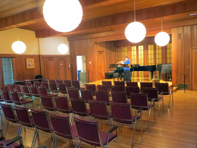 A flutist prepares for an evening concert at the Berkeley Piano Clubhouse