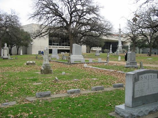 The Pioneer Park Cemetery with the Confederate Memorial and part of the Kay Bailey Hutchinson Convention Center complex in the background.