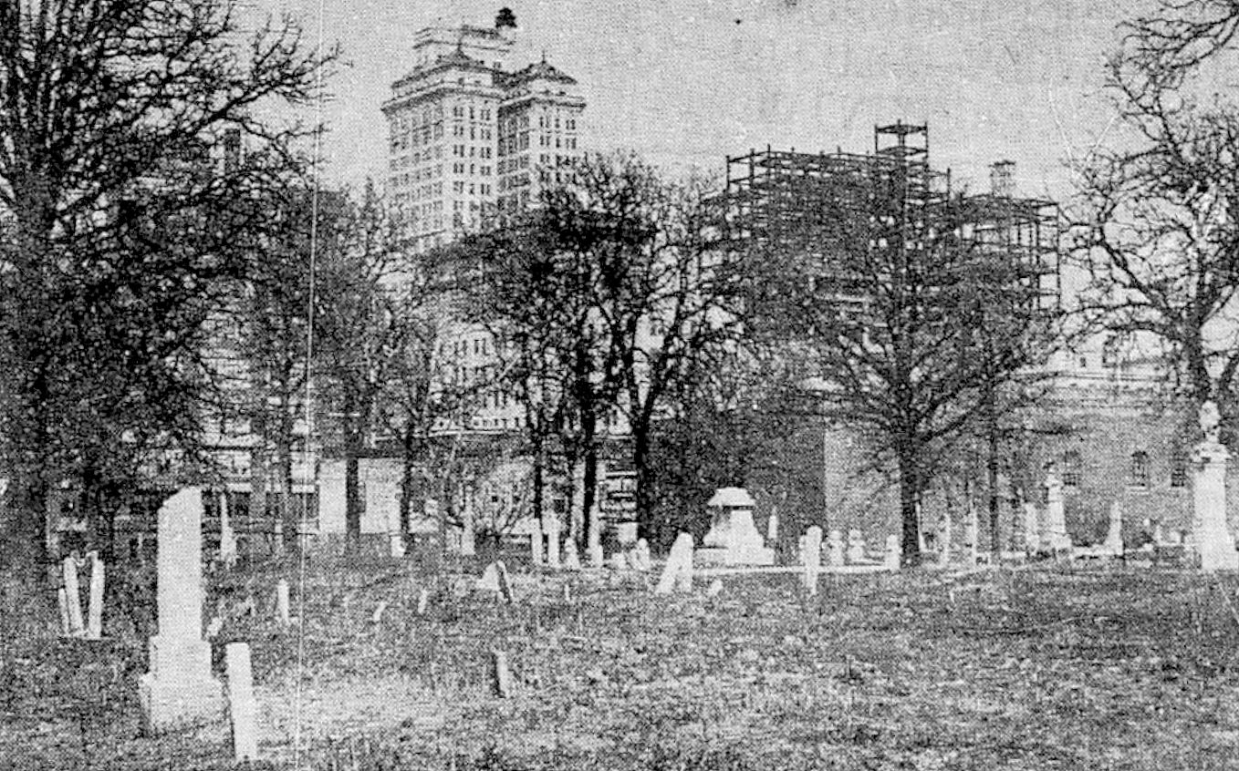 This old photo of the cemetery shows the city growing up around it.  The tall structure in the background is the Magnolia Building.