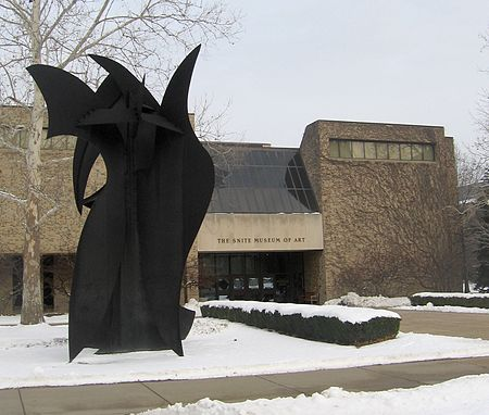 "The Snite Museum of Art. On the left stands ""Griffon"", a large steel sculpture by David Hayes"