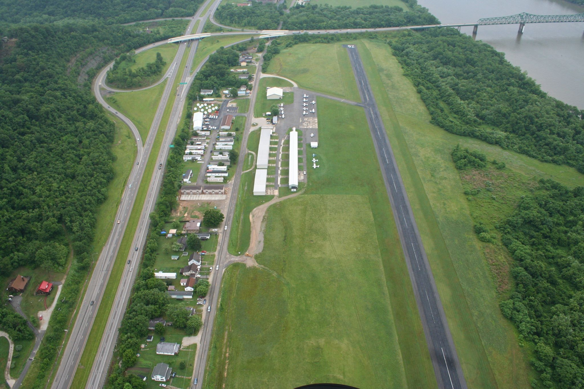 In 1997-1998 after many requests for improvements from the County; the Tri-State Pilots Association, led by Dee Callicoat of Proctorville, raised funds and erected 9 new metal hangers each capable of housing multiple planes.
