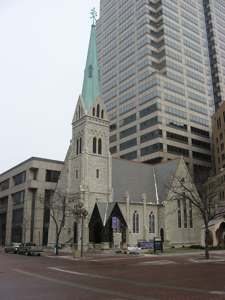 """The """"Little Church on the Circle,"""" completed in 1858, has since been dwarfed by the surrounding buildings."""