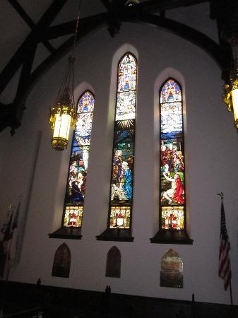 These stained glass windows depict the cathedral's history.