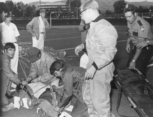 Photo of Wally Benton after his parachute failed to open while skydiving to deliver the game ball on September 11th 1970.