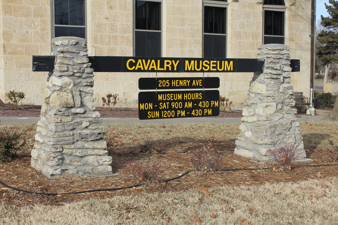Sign outside the Cavalry Museum illustrating address and operating hours.