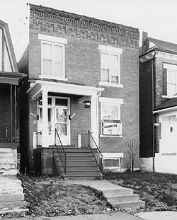 The house is a private residence located on a quiet street lined with similar structures in the predominantly black Fairgrounds Neighborhood of St. Louis
