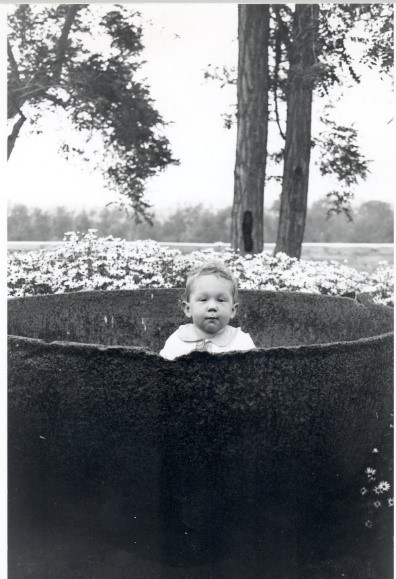 A Bixby grandchild poses in the trypot (1930s)