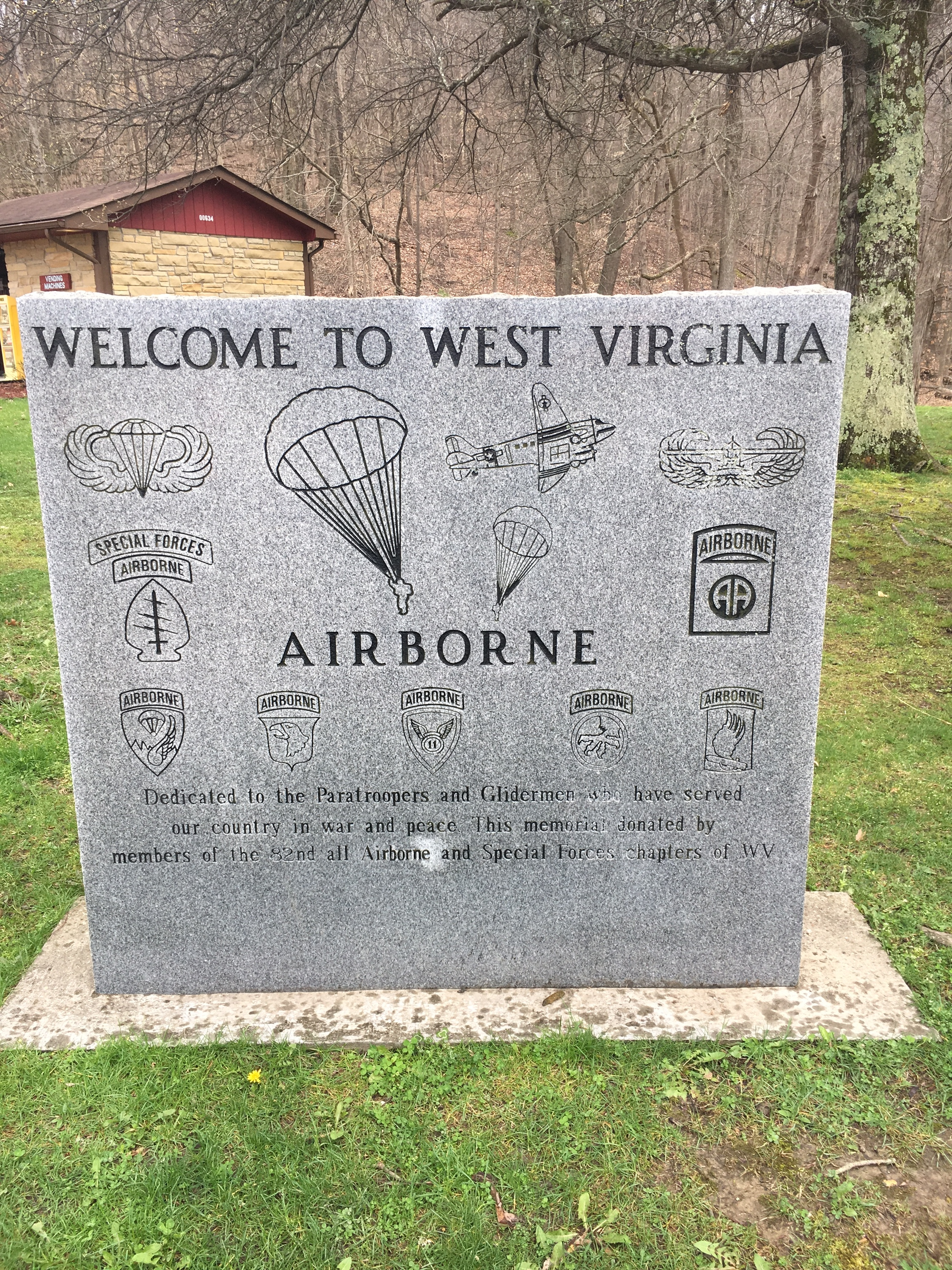 To the right of the West Virginia Welcome Center (opposite of the Blue Star Memorial Highway marker) is the Welcome to West Virginia Airborne Memorial. The building behind it (in the picture) is the vending machines building.