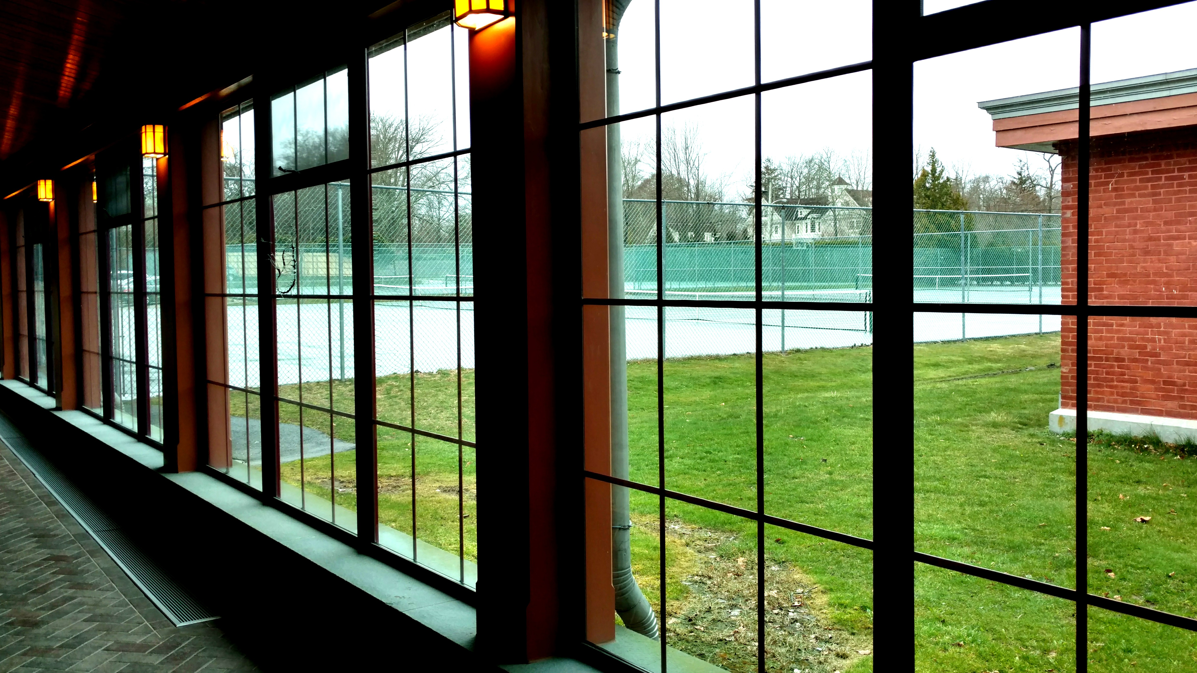 New windows looking out into the tennis courts. This serves as the connector between the Wetmore and Ochre Court structures. Photo taken by Ellen Tuttle.