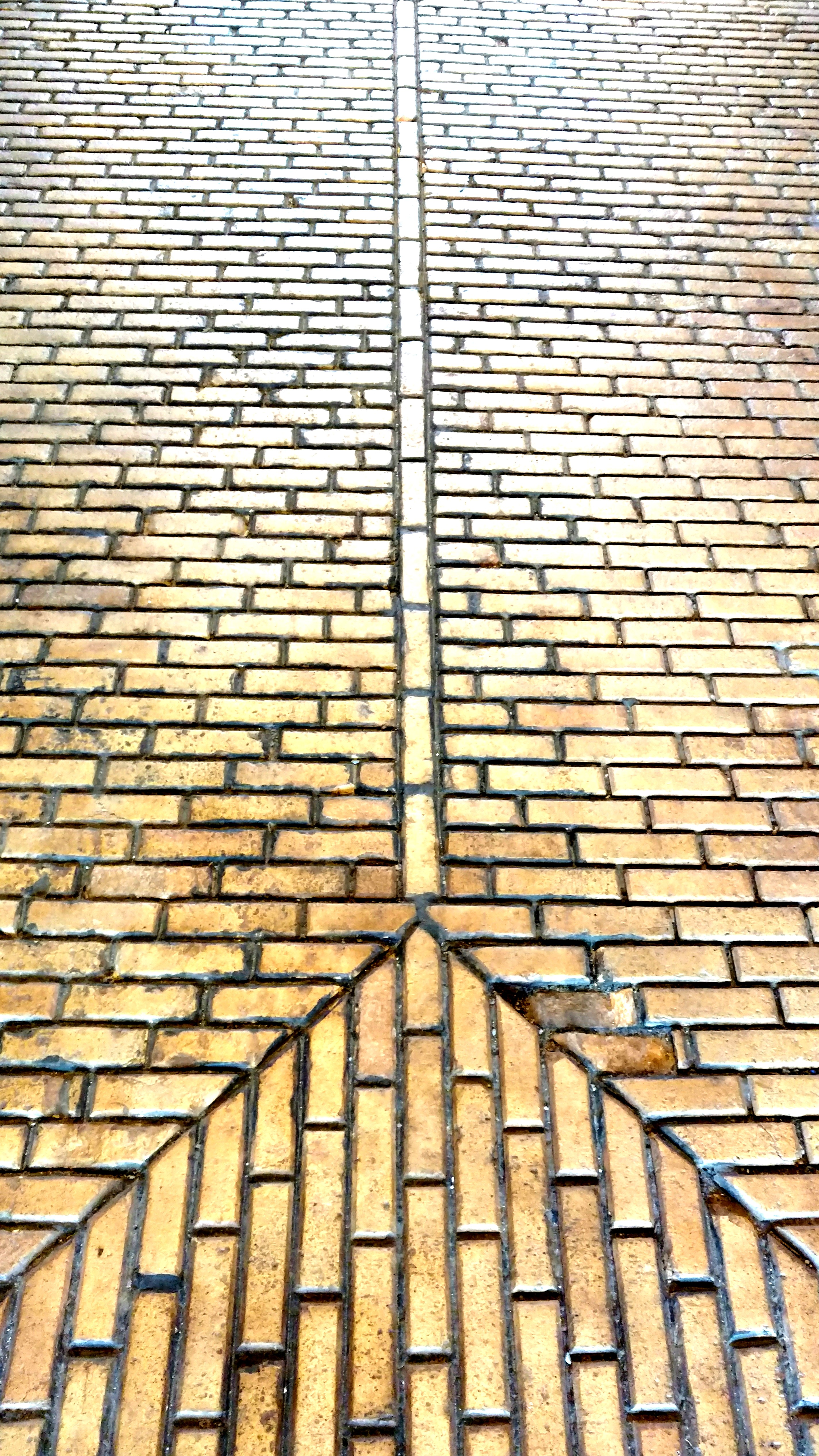 An example of the brick arrangement in the floors of the stables: channels were constructed by the bricks which led to drains. Photo taken by Ellen Tuttle