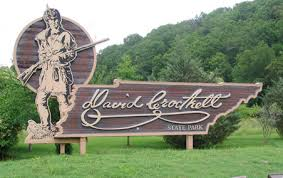 Entrance sign to David Crockett State Park.