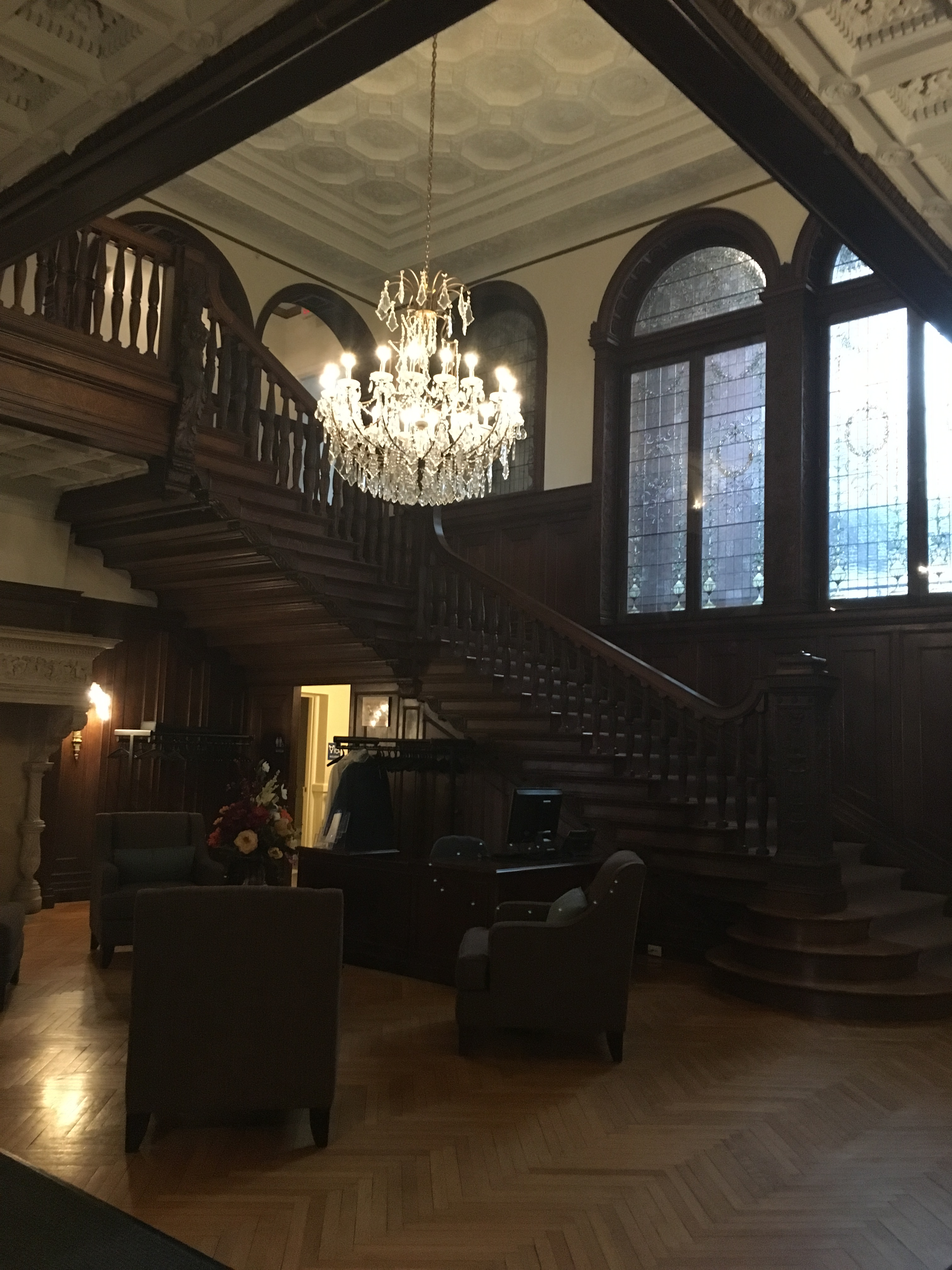 This is the foyer of Fairlawn Estate of which the elegant chandler hangs and the intricate woodwork greets each visitor.